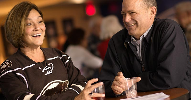 A couple enjoying the Hershey Bears club lounge